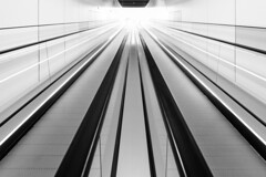 line to eternity (Luke KC) Tags: travelator converginglines leadinglines infinity eternity shoppingcentre escalator bw abstract