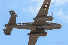 B-25 Mitchell Bombs away !!! (Socal Photography) Tags: 150600 akp aircraft andrewkolstad aviationphotographer jblmawe jblmaweaviation mcchord mcchordfield nikon photographer tamron tamron150600 usaf telephoto b25 fa18f rhino airshow fortlewis