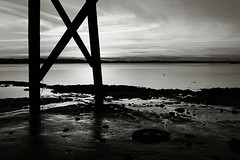 Sunset, Under the Bridge (Robert_Brown [bracketed]) Tags: robertbrown photography photo bridge trestles tide longexposure blackandwhite youngs bay old astoria oregon sunset rippled texture silhouette clouds