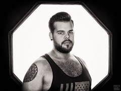 Benni 03 (WF portraits) Tags: aut beard bear hairy tanktop portrait model man male blackandwhite tattoo chest nude naked piercings nose ear