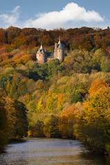 Castell Coch, Autumn III, Wales (welshio) Tags: lighting uk autumn trees winter light history castles southwales wales fairytale clouds forest woodland landscape golden europe stonework gothic towers 19thcentury cardiff victorian atmosphere browns romantic strong welsh yellows monuments reds picturesque autumnal folly forts pictorial gothicrevival romanticism sunandshadow castlecoch redcastle welshcastles senseofplace marquessofbute williamburges romanticlandscape britishlandscapes welshlandscapes arrowholes welshlandmarks