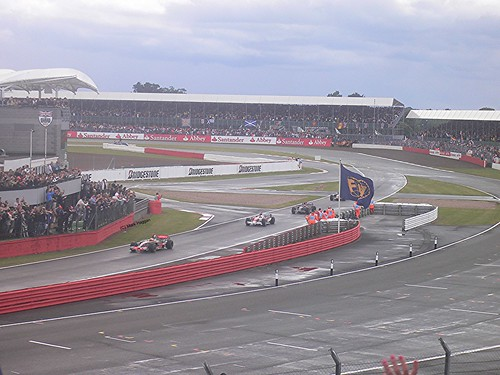 Lewis Hamilton leads the other cars back to the pits after winning the 2008 British Grand Prix