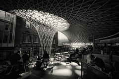 Kings Cross Stn London (Simon Clarkson Photography) Tags: city england people bw london station shop train canon cafe waiting cross britain eating bricks drinking dreaming kings 5d passenger arrival