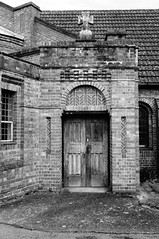 Entrance door (Jon-UK) Tags: windows bw white black brick church details adoremus adorer adorar  adhradh addoliad