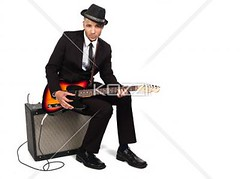 portrait of a young businessman playing guitar (peopleabba2012) Tags: portrait musician music playing man hat electric businessman photography corporate holding sitting guitar fulllength performing professional business suit indoors entertainment whitebackground speaker africanamerican studioshot hobbies musicalinstrument youngadult amplifier ist adultsonly oneperson skill headwear occupation expertise stringinstrument colorimage africanamericanman lookingatcamera leisureactivity oneyoungmanonly onemanonly artscultureandentertainment 2024years
