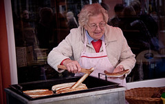 Elderly Woman Serves Bratwurst at Oktoberfest - Idstein, Germany (ChrisGoldNY) Tags: old travel food woman germany deutschland women europa europe european forsale sausage eu oktoberfest meat viajes elderly german posters albumcover alemania bookcover grilled bratwurst vacations bookcovers albumcovers eater deutsche consumerist gridskipper idstein deutscheland jaunted chrisgoldny chrisgoldberg chrisgoldphoto