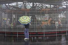 Hurricane Outfit (janniswerner) Tags: street city nyc newyorkcity urban ny newyork storm streets rain umbrella manhattan sandy hurricane streetphotography funky rainy psychedelic raining hurricanesandy