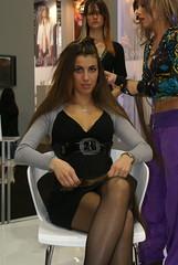 hair model (themax2) Tags: girl 2009 hostess bologna fiera legs miniskirt pantyhose crossed model nylon cosmoprof hair