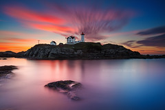 Sea Rocks and Sunrise, Nubble Lighthouse York Maine (Greg DuBois - Sponsored by LEE Filters) Tags: gregdubois nubble lighthouse york maine sunrise searocks longexposure silhouette leefilters bigstopper surreal dreamscape reflection newengland coast northeast north atlantic ocean sea seascape seacoast smooth water waterscape sky clouds cloudy cloud movement motion rocky rugged shoreline canon 6d dark moody wallart photo print photos prints boston photography photographer