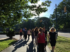 The group took a sunny lap on a morning wellness walk.