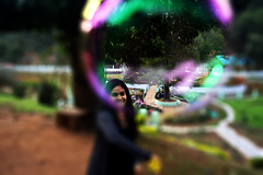 Through the eye of the bubble (AdithyaVR) Tags: bubbles ooty park playing fun blur clear garden playtime
