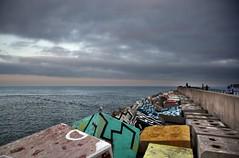 Memorias de la memoria (RalRuiz) Tags: espaa asturias llanes cubosdelamemoria ibarrola marcantbrico faro puerto atardecer cielo nubes gaviota colores