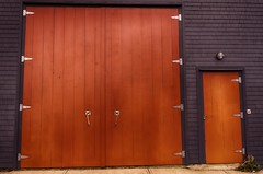 The Big Red Doors (Sonia Argenio Photography) Tags: building bysoniaa design flickr flickrsoniaargenio flickrsoniasgallery novascotia soniasgallery wooden architect bigreddoors black bright brightcolors brightred canada cedar concrete doors handles largedoors latches light lunenburg maritimes metal outdoor photographer red shingles sidewalk silver structure tall