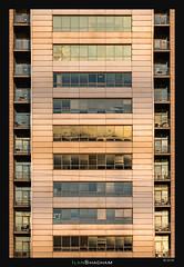 Nine Golden Stories (Ilan Shacham) Tags: windows nine gold goldenlight repetition symmetry reflection petahtikva architecture abstract israel adgar tower window