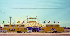 BIG TOP COMES TO SMALL TOWN (akahawkeyefan) Tags: circus circo flags tent trailers sanger davemeyer signs