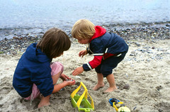 Collecting stones at the Beach (Batikart) Tags: ocean sea summer sky people playing beach nature water childhood germany landscape toy kid sand europe day child play outdoor sister brother stones siblings balticsea barefoot 1985 rainwear collector 2012 schleswigholstein timmendorferstrand niendorf batikart fototrove