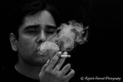 Smoking (rajnishjaiswal) Tags: portrait bw man nikon cigarette smoke gimp 85mm smoking strobe d90 blackandwhite blinkagain mansmokingcigarette