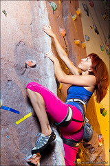 Athletic red haired girl climbing an artificial rock (Dmitry Mordolff) Tags: girls woman mountain sports beautiful smiling wall female club person one moving women rocks exercise reaching action muscular blueeyes extreme teenagers rope safety equipment indoors climbing health hanging leisure effort balance strength athlete harness redhair gym stretching courage caucasian recreational adolescence exercising clambering