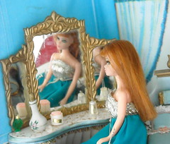 Glori ponders her image in the dressing table mirror (Emily1957) Tags: reflection reflections dawn mirror turquoise makeup shoulders shoulder topper dressingtable perfumebottle mirrorreflection mrsdalloway glori petiteprincessdollhouse portraitdawndollglori bluebelle722gown