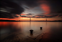 South Queensferry Sunset (angus clyne) Tags: ocean new trip bridge sunset red cloud art water ferry night zeiss photoshop canon river dark lens landscape prime scotland pier boat photo focus edinburgh long exposure ship glow angle time fife dusk jetty south tide wide picture scottish wave queens forth filter workshop lee nd layers grad bollard cpl graduated lothian firth gloaming 18mm distagon tutuorial canon5dmarkii zeissdistagont18mm
