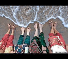 when the waves become a blanket.. (g sivaprasad) Tags: ocean girls sea water waves legs lakshmi tide shore blanket seashore rakhi parvathy lekha sivaprasad kanhangad gsivaprasad