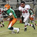 Canes Defensive End Shawn Lawrence chases after Ely Quarterback Tyquan Fields