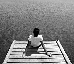 dreaming... ((rino)) Tags: boy blackandwhite bw lake water dock flickr dream dreaming rino