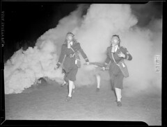 2 women doing a fire drill with masks on (Boston Public Library) Tags: smoke gasmasks lesliejones firefightingequipment