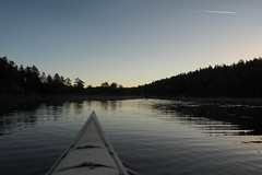 Airliner passing (cablefreak) Tags: morning lake water early kayak sweden jetstream paddling