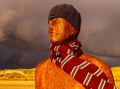 Keeping the Iron man warm :) (Bev Goodwin) Tags: england sky storm black liverpool antonygormley merseyside anotherplace ironmen crosbybeach sonya37