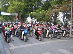 Motorbikes on a Hanoi street (mbphillips) Tags: fareast southeastasia 越南 ベトナム 베트남 asia アジア 아시아 亚洲 亞洲 mbphillips canonixus400 geotagged photojournalism photojournalist hanoi capital 首都 수도 travel việtnam vietnam vietnamese