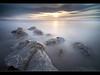 Shiver (A-D-Jones) Tags: ocean light sea sun seascape reflection beach water misty set clouds liverpool rocks long exposure dusk 10 boulders stop crosby blending merseyside blundellsands