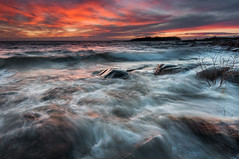 First sunset III (- David Olsson -) Tags: sunset lake plant seascape motion nature water clouds landscape movement log bush nikon rocks waves sundown cloudy sweden stones tripod january vivid windy newyear firstday colourful vnern dx hammar vrmland 1635 1635mm lakescape skoghall 2013 d5000 davidolsson 1635vr grytudden