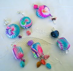 Colors in the cold wind (klio1961) Tags: necklace handmade spirals bijou jewellery polymerclay fimo clay spinning faux sculpey swirls sparkling swirly shimmering cernit pendants abalorios joyas premo focalbeads