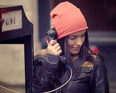 The Payphone (John Westrock) Tags: seattle woman smile smiling female canon pose person downtown phone phonebooth candid posing communication payphone 7d wa washingtonstate legacy tinted leatherjacket pioneersquare flickrmeetup handset pinkhat seattleflickrmeetup 135f2l 4x5crop juxtdarkroom2 mse1301juxt