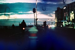 life on the seafront (fotobes) Tags: light sky trafficlights cars clouds buildings xpro brighton cyclist dusk crossprocess grain olympus om10 seafront cyclepath railings bollards agfaprecisa100 olympusom10 norightturn brightonseafront filmsoup