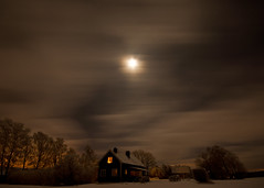 home (Andreas Lf) Tags: longexposure nightphotography trees winter sky moon house snow cold home night clouds rural stars countryside cozy sweden tripod cottage nopeople fullmoon le scandinavia woodenhouse inviting warmlight sigma1020mm stergtland cloudmovement nordics vretakloster cloudmotion sonyalphaslta77 mjlorp