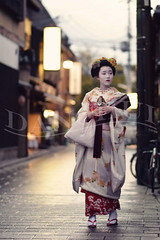 Grace (Dan Chui (on/off!)) Tags: street travel flowers red portrait motion beautiful japan umbrella reflections geotagged lights evening nikon kyoto asia neon pattern afternoon sandals candid traditional famous citylife makeup 85mm landmark illuminated maiko geiko geisha    kimono gion geta  d800 elegance pavingstone femininity waxpaper kanzashi     obisash mameroku