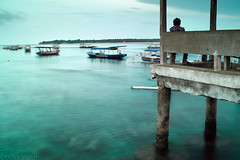 A lone fisherman (tsiklonaut) Tags: ocean travel sunset sea seascape motion beach port indonesia boats island boat asia jetty indian sigma experience southeast float gili  motionless indonesian timeless discover foveon x3 trawangan    dp2     ilslands        dp2s tsiklonaut