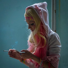 Smoke Break (tim.perdue) Tags: smoke break girl woman person figure candid street cosplay costume pink hair cigarette iphone hoodie rabbit ears hands smoking face texting columbus matsuricon ohio convention center anime portrait