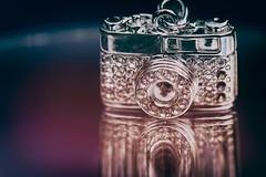 Macro Monday - In the mirror (cuppyuppycake) Tags: maco monday mirror camera jewlery reflection shiney
