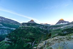 Sunrise in Glacier (waterrocksnow) Tags: glaciernationalpark nationalpark glacier national park sunrise glow peak mountain landscape forest waterfall trees rocks craggy vivid expanse vast sky