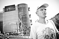 Both of Us Worried (stimpsonjake) Tags: nikoncoolpixa 185mm streetphotography bucharest romania city candid blackandwhite bw monochrome faces worried highcontrast billboard man