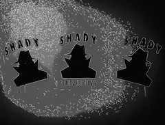 The Shady Collective (Steve Taylor (Photography)) Tags: shady collective drips runs hat overcoat samspade art digital graffiti stencil streetart black grey monochrome blackandwhite monotone eerie weird strange newzealand nz southisland canterbury christchurch city shape outline vignette man men ymca festival spectrum shades