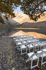 Sunrise w/o Audience (Chicken) Tags: california morning autumn trees wedding usa white lake mountains reflection fall water leaves sunrise missing unitedstates audience chairs serene canopy mammothlakes sierranevada tranquil gravel absence convictlake