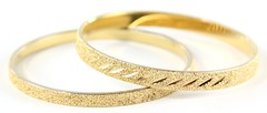 1011. (2) Gold-toned Bracelets