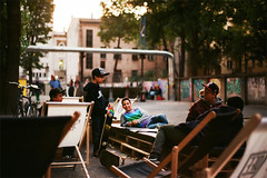 a place called HOME (the aurelian) Tags: street city sunset urban film girl smile bike analog graffiti evening pub nikon picnic skateboarding dom streetphotography skaters skateboard halfpipe handheld fujifilm streetphoto hangingout postindustrial fm2 lodz d wideopen superia200 sunbeds fm2n piotrkowska skateculture alternativeculture nikonfm2n nikkor18d hammockchairs theaurelian