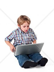 cute little boy using laptop (peoplebeck2012) Tags: boy cute male childhood computer photography portable sitting technology child laptop web internet innocent fulllength adorable indoors whitebackground elearning learning studioshot wirelesstechnology browsing caucasian casualclothing colorimage oneboyonly 67years elementaryage informationmedium