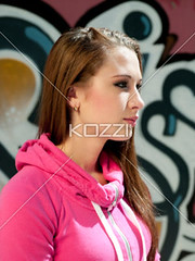 teenage girl against graffiti (kristpeople2012) Tags: sunlight cute beautiful beauty wall closeup female painting creativity outdoors photography graffiti day looking teenager casual daytime graffito sideview casualwear oneperson paintedwall caucasian headandshoulders casualclothing colorimage blankexpression 1617years oneteenagegirlonly onegirlonly