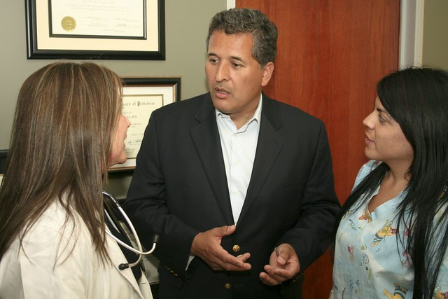 Juan speaking with medical professionals